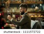 man is tasting the wine....   Shutterstock . vector #1111572722