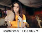 woman in a restaurant fighting... | Shutterstock . vector #1111583975