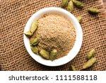 elaichi or cardamom powder in... | Shutterstock . vector #1111588118