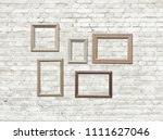 old photo frames on brick wall | Shutterstock . vector #1111627046