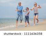 father and kids running on the... | Shutterstock . vector #1111636358