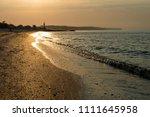 morning on the seashore. dawn... | Shutterstock . vector #1111645958
