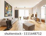 blanket on grey couch in... | Shutterstock . vector #1111648712