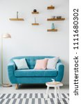 blue couch next to a pink lamp... | Shutterstock . vector #1111680302