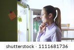 young woman in the kitchen  she ...   Shutterstock . vector #1111681736