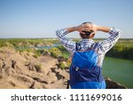 photo from back of young... | Shutterstock . vector #1111699016