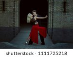 couple during the performance... | Shutterstock . vector #1111725218