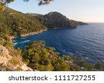 sunset illuminates the sea ... | Shutterstock . vector #1111727255