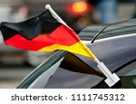 german flag blowing in the wind ... | Shutterstock . vector #1111745312