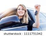 an attractive woman in a car... | Shutterstock . vector #1111751342