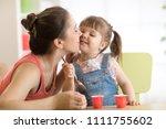 toddler child girl is having... | Shutterstock . vector #1111755602