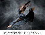 Dancer In The Black Background