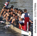 Small photo of KAOHSIUNG, TAIWAN -- JUNE 10, 2018: A team of sailors from the navy prepares for the upcoming Dragon Boat Races.
