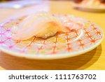 in a conveyor belt sushi... | Shutterstock . vector #1111763702