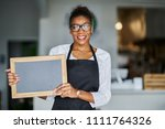 friendly african american shop... | Shutterstock . vector #1111764326