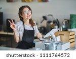 friendly shop assistant ready... | Shutterstock . vector #1111764572