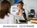 friendly african american... | Shutterstock . vector #1111764608