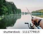 fisherman with rod  spinning... | Shutterstock . vector #1111779815