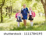 happy mom and two daughter... | Shutterstock . vector #1111784195