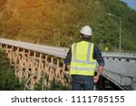engineers wear  helmet looking... | Shutterstock . vector #1111785155