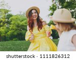 laughing woman in yellow... | Shutterstock . vector #1111826312