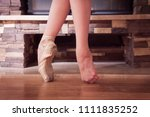 the ballerina stands on her... | Shutterstock . vector #1111835252