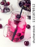 cold drink with cherry in jars... | Shutterstock . vector #1111878512