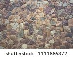 texture of a stone wall the... | Shutterstock . vector #1111886372