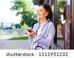 mature attractive stylish woman ... | Shutterstock . vector #1111951232