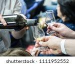 hands holding a snifter glass...   Shutterstock . vector #1111952552