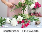 woman create a bouquet of... | Shutterstock . vector #1111968488