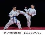 children are training karate... | Shutterstock . vector #1111969712
