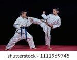 children are training karate... | Shutterstock . vector #1111969745