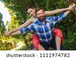 loving couple enjoying in... | Shutterstock . vector #1111974782