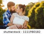 happy romantic couple sits in... | Shutterstock . vector #1111980182