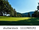 golf course on a sunny day in... | Shutterstock . vector #1111985192