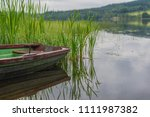 a small rowing boat  by the... | Shutterstock . vector #1111987382
