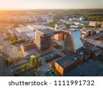 A large building with laboratories and innovative projects, inventions of a technical nature in the Technopark of the Novosibirsk Academic Township ain sunny day Aerial view