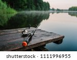 fishing rod  spinning reel on... | Shutterstock . vector #1111996955