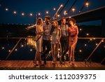 shot of a group of friends... | Shutterstock . vector #1112039375