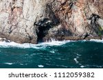 caves at the bottom of sea... | Shutterstock . vector #1112059382