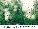 on transparent glass rain drops ...   Shutterstock . vector #1112076152