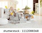 beautiful young woman wearing...   Shutterstock . vector #1112088368