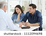 young couple discussing pension ... | Shutterstock . vector #1112094698