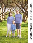 happy family in summer park   Shutterstock . vector #1112100686
