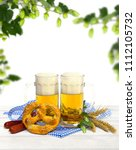 bavarian pretzels  wheat ears ... | Shutterstock . vector #1112105732
