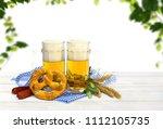 bavarian pretzels  wheat ears ... | Shutterstock . vector #1112105735