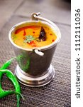 north india food tadka dal in... | Shutterstock . vector #1112111036