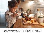 child girl preparing breakfast... | Shutterstock . vector #1112112482