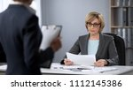 serious businesswoman strictly... | Shutterstock . vector #1112145386